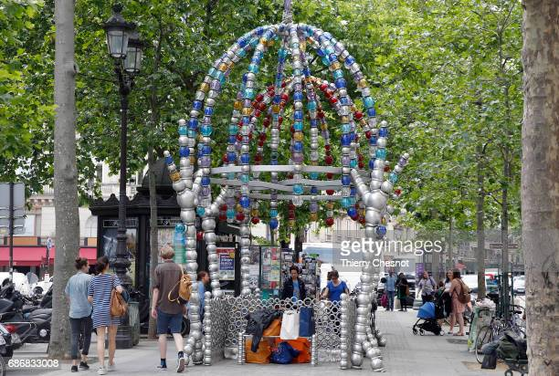 The entrance to the metro station Palais RoyalMusee du Louvre is seen on May 22 2017 in Paris France The entrance to this subway station was built by...