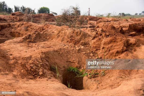 The entrance to the Nkanzala abandoned mine is pictured in Tshikapa in Democratic Republic of Congo's central Kasai region on July 29 2017 The...