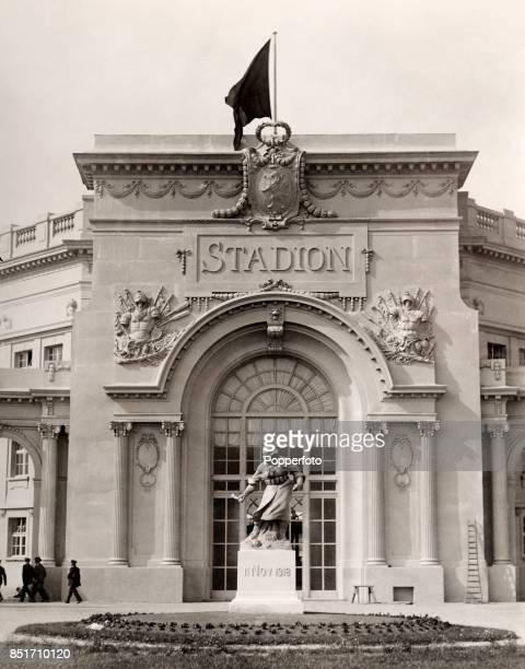 The entrance to the Olympic Stadium in Antwerp, with a World War One commemorative statue in the foreground, during the Antwerp Olymipic Games on...