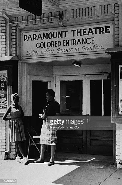 The entrance to the Paramount Theater showing a sign reading 'Colored Entrance' 1962