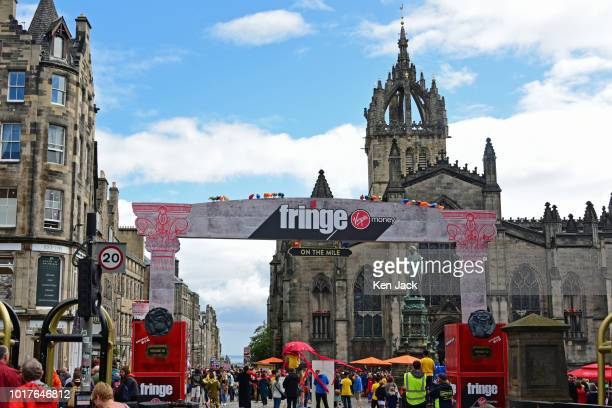 The entrance to the pedestrian area on the Royal Mile during the Edinburgh Festival Fringe with St Giles' Cathedral in the background on August 16...