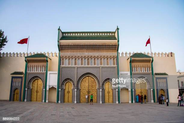 The entrance with the golden gates in the old Royal Palace in Fez Morocco
