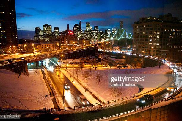 CONTENT] The entry ramp from Brooklyn Queens Expressway going onto the Brooklyn Bridge near Washington Street Taken at night after sundown with blue...