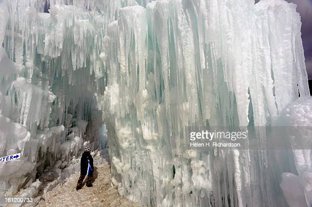 The entry way to the Ice Castle is covered with huge hanging icicles The Ice Castles at Silverthorne are an unparalleled creation of walkways...