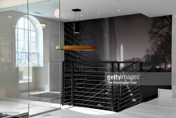 The entryway to Laura Kiker's apartment building features murals of iconic DC sites November 12 2017 in Washington DC Kiker's building previously was...