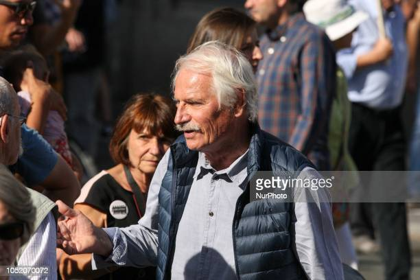 The environmentalist activist journalist and photographer Yann ArtusBertrand takes part in march against climate change in Paris on October 13 2018