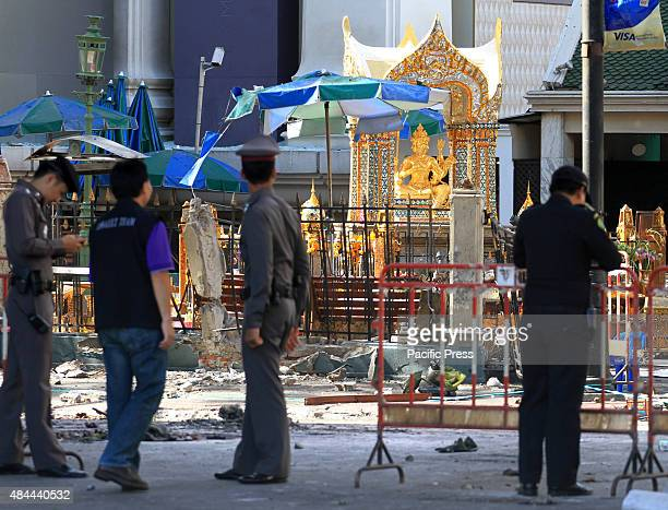 The EOD officers and probation officers check for evidence where the blast occurred. The explosion occurred at the Erawan shrine, at the...
