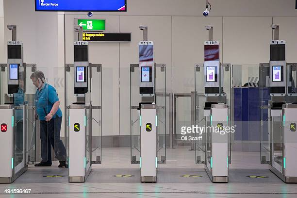 The 'ePassport gates' at Gatwick Airport's Passport Control on the UK Border on May 28 2014 in London England Border Force is the law enforcement...