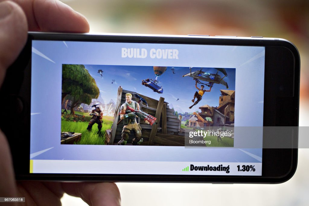 Battle Royale video game is displayed for a photograph on an Apple Inc. iPhone in Washington, D.C., U.S., on Thursday, May 10, 2018. Fortnite, the hitgamethat's denting the stock prices of video-gamemakers after signing up 45 million players, didn't really take off until it became free and a free-for-all. Photographer: Andrew Harrer/Bloomberg via Getty Images