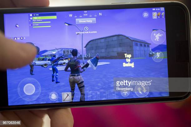 Battle Royale video game is displayed for a photograph on an Apple Inc iPhone in Washington DC US on Thursday May 10 2018 Fortnite the...
