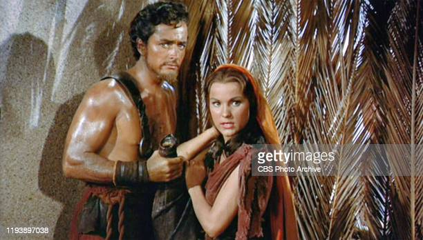 The epic movie The Ten Commandments directed by Cecil B DeMille Seen here from left John Derek as Joshua a stonecutter and Debra Paget as Lilia a...