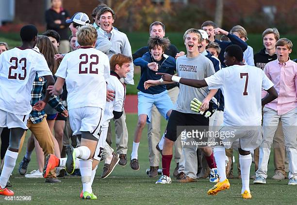 The Episcopal High students celebrate with the team after Episcopal's Gaetan Roux center in front of 22 scored a goal against St Stephen's/St Agnes...