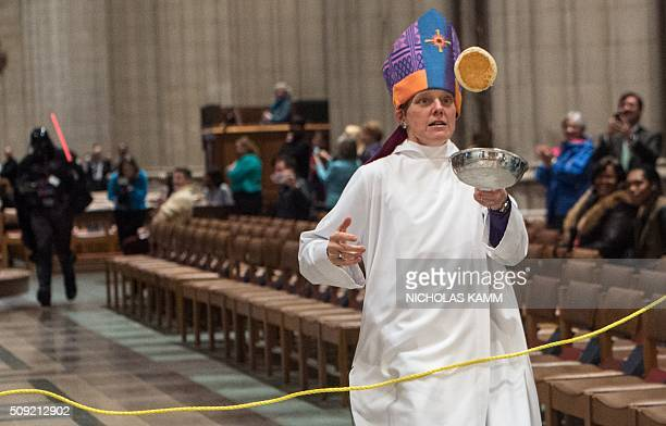 The Episcopalian Bishop of Washington Mariann Edgar Budde flips a pancake during the Shrove Tuesday Pancake Race at the National Cathedral in...