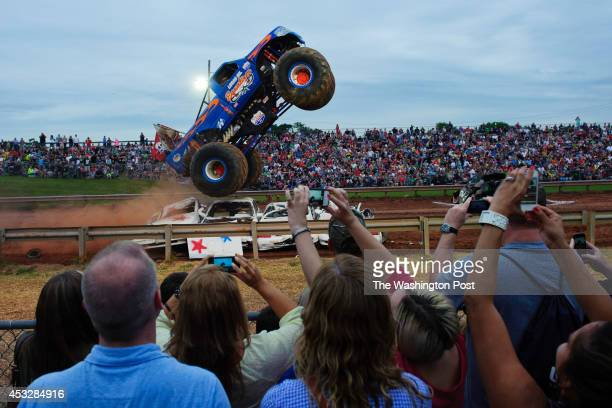 The Equalizer driven by Mike Hawkins drives over wrecked cars during the Monster Truck competition at the grandstand at the Prince William County...