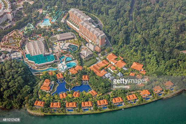 The Equarius Hotel top center the Beach Villas bottom and the Adventure Cove Waterpark center left at the Resorts World Sentosa integrated resort and...