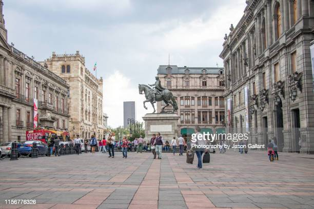 the equestrian statue of charles iv of spain in the plaza manuel tolsá outside of the museo nacional de arte in mexico city. - arte stock photos and pictures