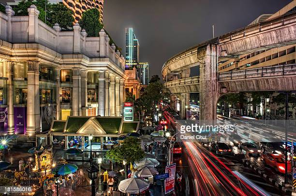 CONTENT] The Erawan Shrine which houses the famous Phra Phrom statue near a busy intersection at night and in the rain