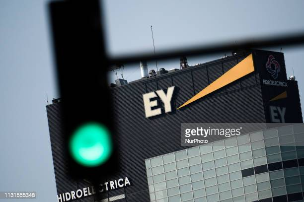 The Ernst and Young logo is seen on a building in central Bucharest Romania on October 9 2018 Ernst and Young is one of the quotBig Fourquot...