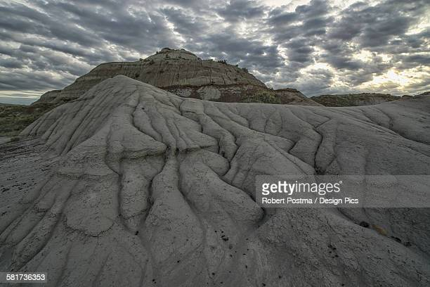 The erosion around Drumheller, Alberta, forming interesting formations and hoodoos in Dinosaur Provincial Park at sunset