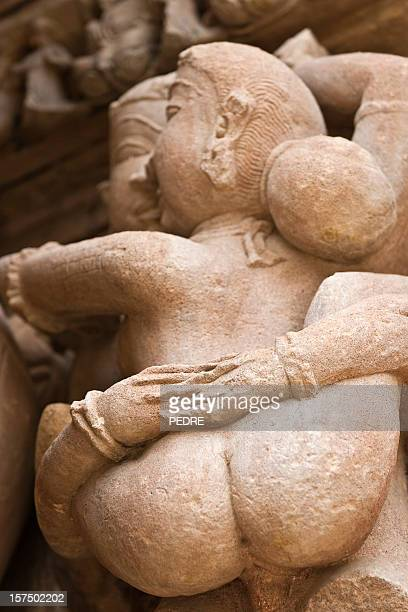 the erotic statues in khajuraho - nude hindu women stock photos and pictures