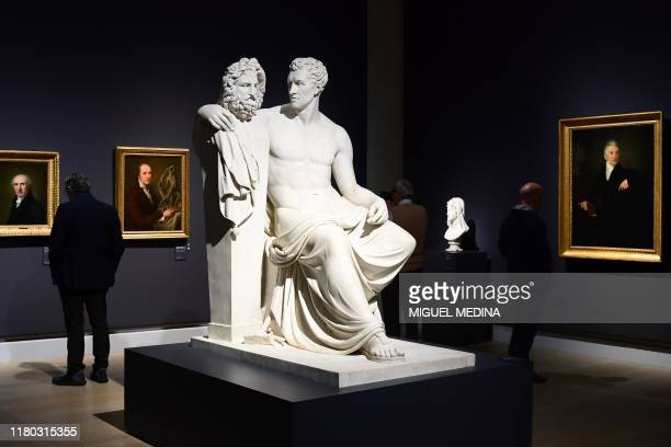 Visitors view the Neoclassical marble sculpture Antonio Canova Seated with His Arm Around the Phidian Herm of Jupiter by Italian sculptor Giovanni...
