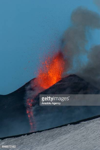 The eruptive activity of the volcano Etna's southeast crater is seen from 2700 meters above mean sea level on March 1 2017 in Catania Italy The...