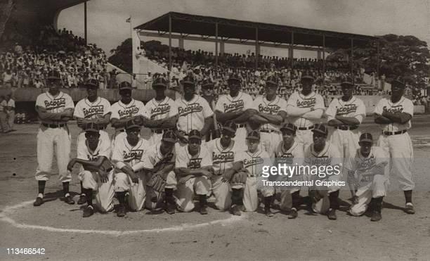 The Escogido Baseball Club poses for their team shot circa 1937 in Santo Domingo, Dominican Republic. Martin Dihigo, their star pitcher, stands in...