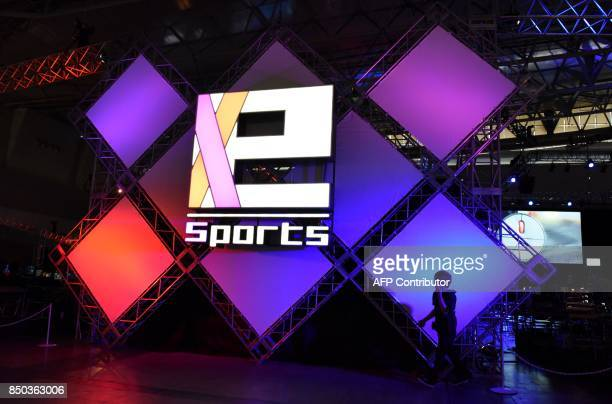 The 'eSports' logo is displayed at the Tokyo Game Show in Chiba City in suburban Tokyo on September 21 2017 Star game players geared up for digital...