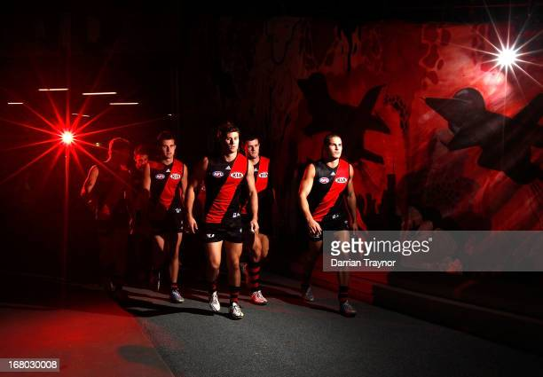 The Essendon Bombers walk from the rooms after the half time break during the round six AFL match between the Essendon Bombers and the Greater...