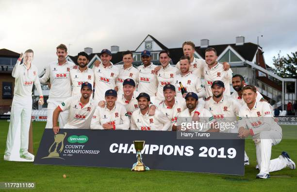 The Essex side pose for a team photo after winning the County Championship during Day Four of the Specsavers County Championship Division One match...