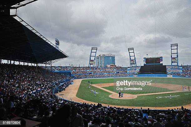 The Estadio Latinoamericano is filled with people watching an exhibition game between the Cuban national baseball team and Major League Baseball's...