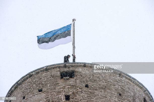 The Estonian flag is pictured at the Estonian Parliament during a festive ceremony to celebrate 100 years since Estonia declared independence for the...