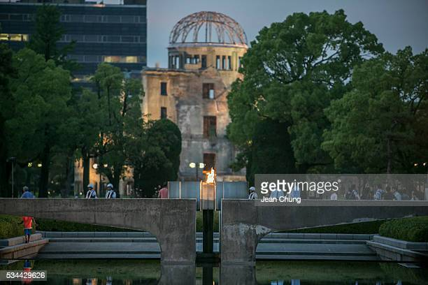 The eternal flame burns as the Atomic Bomb Dome stands behind inside Peace Memorial Park on May 26 2016 in Hiroshima Japan On May 27 President Barack...