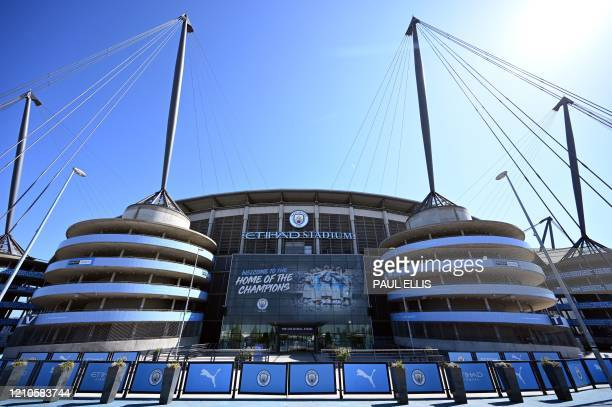 The Etihad Stadium complex home to English Premier League football team Manchester City is pictured in Manchester northen England on April 21 as life...