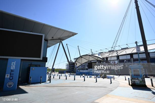 The Etihad Stadium complex home to English Premier League football team Manchester City is pictured in Mancheser northen England on April 21 as life...