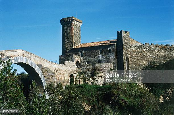 The Etruscan bridge and Abbey of Vulci castle 12th century now home to the Etruscan Museum Vulci Natural Archaeological Park Lazio Italy