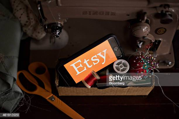 The Etsy Inc logo is displayed for a photograph on a smartphone next to sewing supplies in Tiskilwa Illinois US on Tuesday Jan 20 2015 Etsy Inc the...