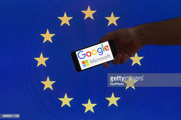 The EU flag is seen with Google and Microsoft logos