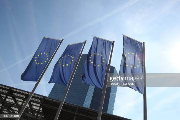 The EU flags are seen in front of the European Central Bank in Frankfurt/Main Germany on September 8 2016 The European Central Bank held its...
