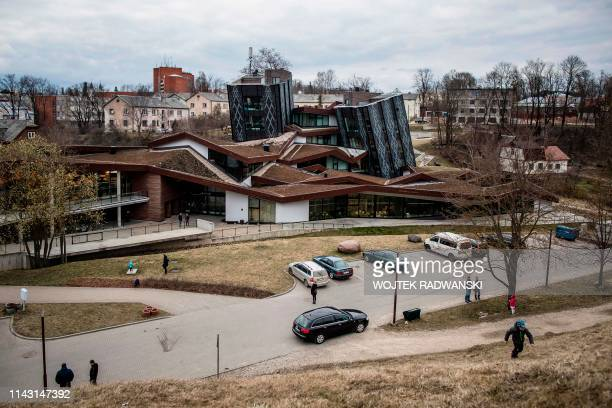 The EU funded Zeimuls Cultural Center building is pictured on April 9, 2019 in Rezekne, eastern Latvia. - A Latvian border guard helicopter hovers...