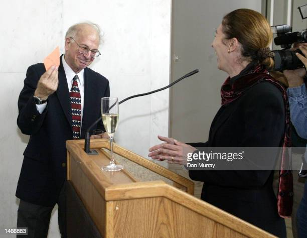 The Eugene Higgins Professor of Psychology and professor of public affairs, Daniel Kahneman receives a very special parking lot pass from Anne-Marie...