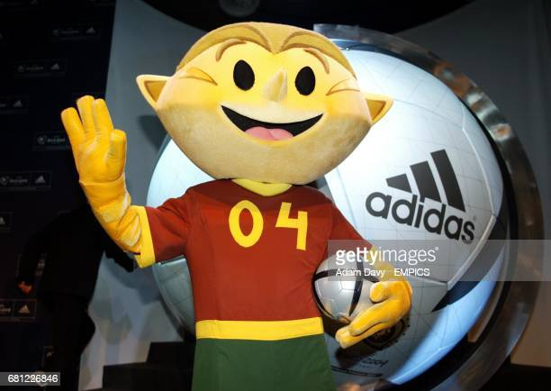 The Euro 2004 mascot Kinas with the new Adidas Match ball
