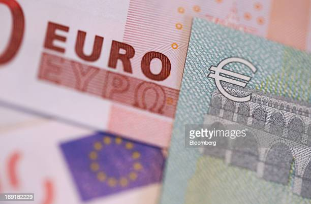 The euro currency symbol is seen on a five euro note right in this arranged photograph in London UK on Tuesday May 21 2013 Croatia which will join...