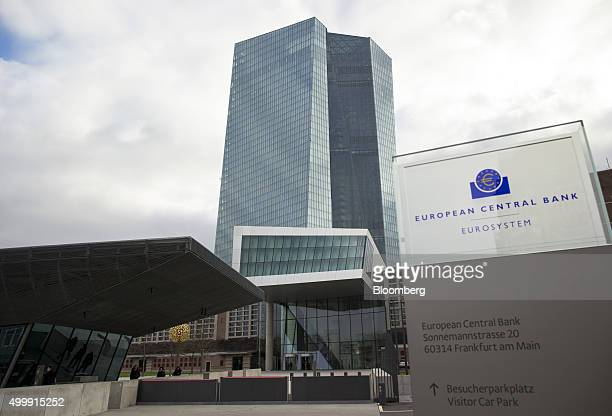 The euro currency symbol sits on a sign outside the European Central Bank headquarters in Frankfurt Germany on Thursday Dec 3 2015 European stocks...
