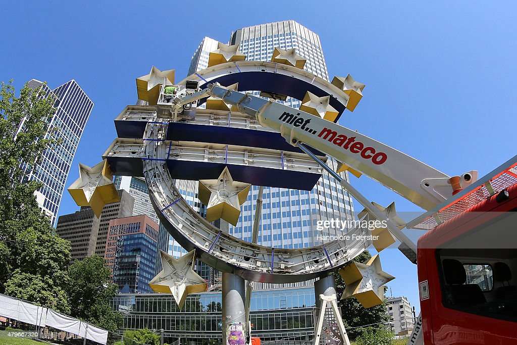 The Euro sculpture, near the old ECB headquarters, undergoes maintenance on July 6, 2015 in Frankfurt, Germany. The DAX dropped slightly in the morning though investors remain cautious as the consequences of the referendum remain uncertain. Greeks voted in a strong majority against the reform plan proposed by the troika of the European Central Bank, the International Monetary Fund and the European Commission in a move that many fear will lead to a departure by Greece from the Eurozone.