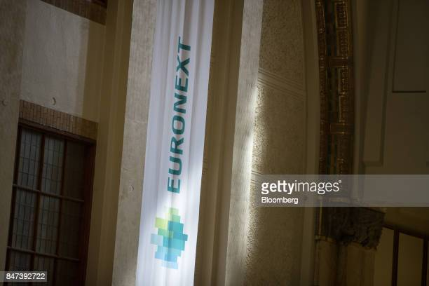 The Euronext NV logo sits on a banner hanging inside the Amsterdam Stock Exchange in Amsterdam Netherlands on Friday Sept 15 2017 Frankfurt has the...