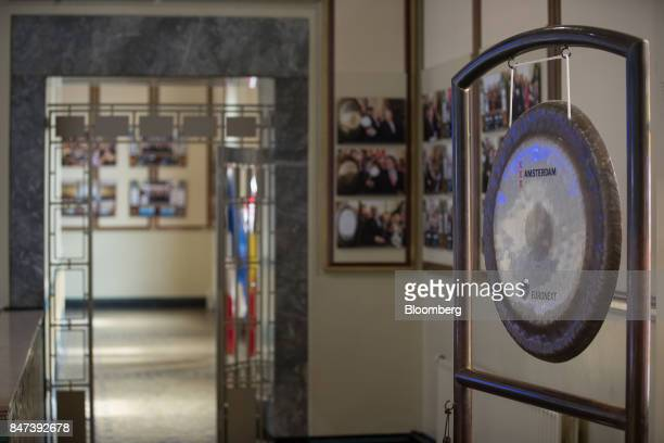 The Euronext NV logo sits on the opening gong inside the Amsterdam Stock Exchange in Amsterdam Netherlands on Friday Sept 15 2017 Frankfurt has the...