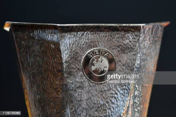 The Europa league football trophy is displayed during the draw for the Europa League round of sixteen on February 22 2019 in Nyon