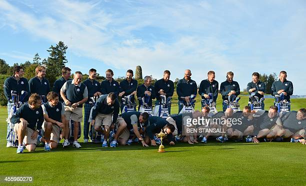 The Europe Ryder Cup golf team members and their caddies pose for pictures at the Gleneagles golf course in Gleneagles Scotland on September 23 ahead...