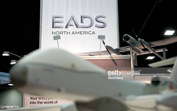 The European Aeronautic Defence Space Co North America logo is seen past a Cassidian Ltd a unit of EADS Future MALE unmanned aircraft system on the...
